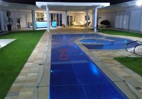 Casa de Condomínio com 4 Quartos à venda, 939m²